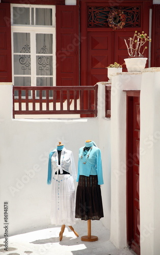 Two mannequins dressed in courtyard