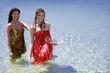 Two young women posing in water