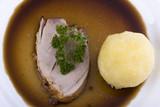 bavarian roast pork dish with potato dumpling poster