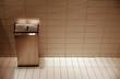 Garbage can in public bathroom