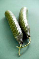 Cucumbers;green background