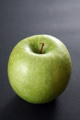 Granny Smith apple;black background