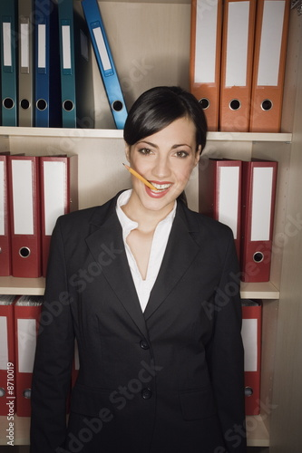 Office worker with pencil in her mouth