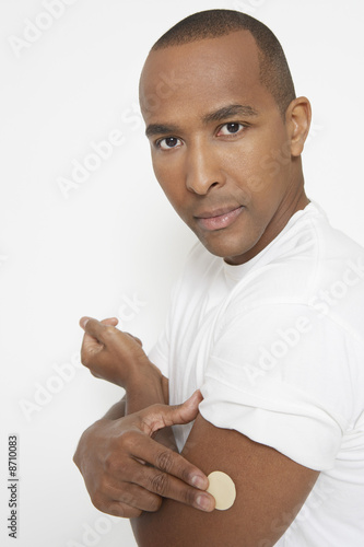 Man with patch on arm, portrait