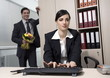 Male office worker hiding flowers for female colleague