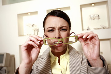 Woman with eyeglasses squinting