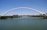 bridge built on Guadalquivir river, Seville, Spain poster