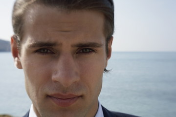 Closeup of businessman on the beach