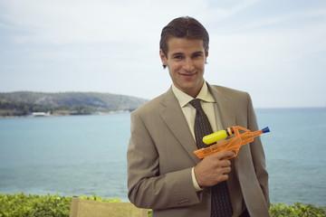 Businessman with plastic water gun