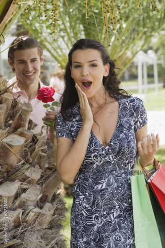 Woman with shopping bags;man with rose