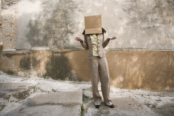 Businesswoman with head in a box