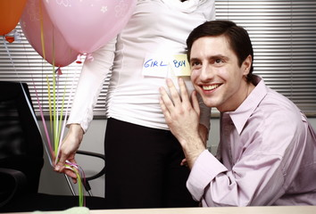 Office worker guessing the sex of colleague's baby