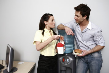 Male and female office workers eating take out food