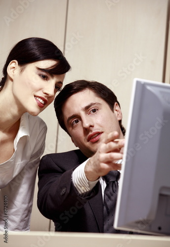 Businessman and woman at computer