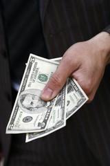 Closeup of hand holding dollars