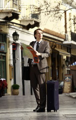 Businessman with a map *** Local Caption *** Business people enjoying the relaxed environment of the Southern European way of doing business