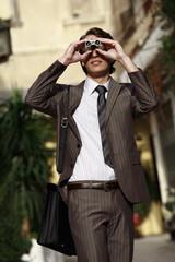 Professional looking through binoculars