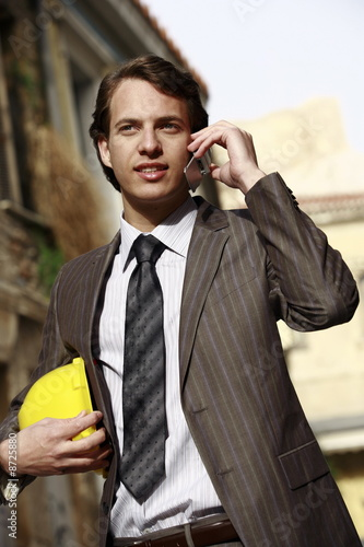Man in suit with hard hat