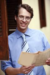 Businessman holding a newspaper