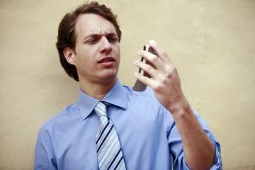 Businessman looking at his cell phone