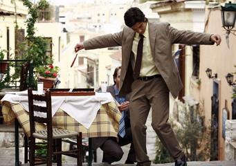 Two businessmen Greek dancing