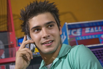 Closeup of male teenager on cell phone