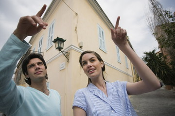 Man and woman pointing