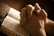 Praying hands on an open bible - 8737496