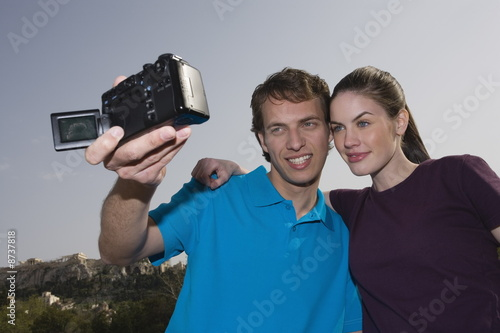 Couple at archaeological site photographing themselves