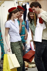 Two couples shopping for a tee shirt