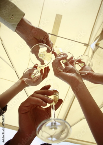Hands with champagne glasses toasting