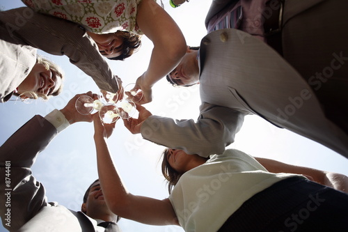 Group of people with champagne glasses toasting