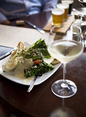 Appetizer salad and white wine