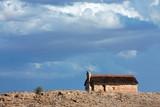 Thatched hut landscape, Kalahari desert, South Africa poster