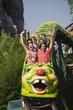 Teenagers on amusement park ride