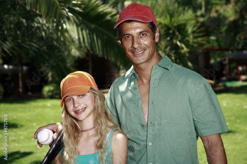 Father and daughter with baseball outfit