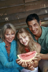 Parents with daughter and watermelon