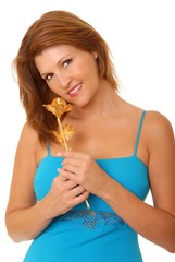 Lovely Redhead Girl with golden rose
