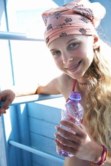 Girl on the beach with water bottle
