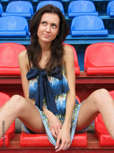 Sexy girl with long legs at the stadium