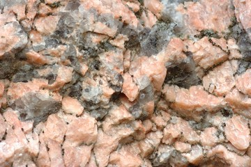 Texture of stone consisting of white and pink quartz