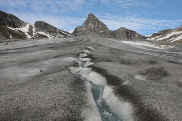 Small and fast creeks on glacier are plentiful.