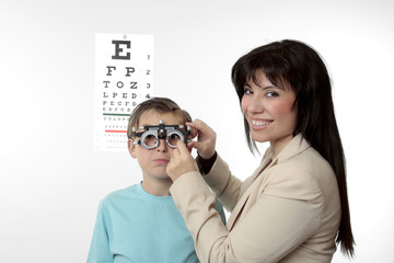 Optometrist and child patient