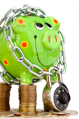Piggy bank locked in chain