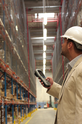 An inspector with bar code reader counting stock
