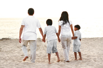 Family Walking Down the Beach