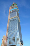 Highrise building in construction over blue sky poster