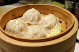 Close up of Shanghai soup dumplings in bamboo steamer poster