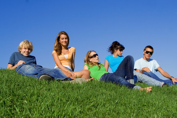 group of happy youth chilling out at summer camp