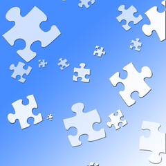 puzzle pieces on a soft blue background